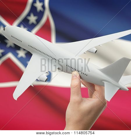 Airplane In Hand With Us State Flag On Background - Mississippi