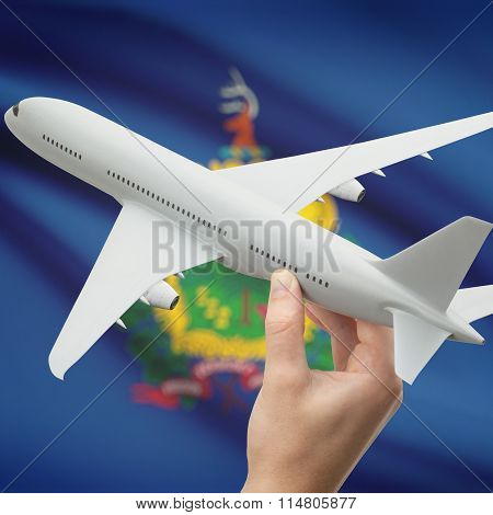 Airplane In Hand With Us State Flag On Background - Vermont