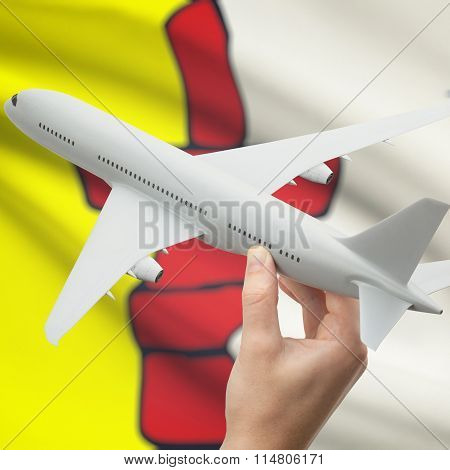 Airplane In Hand With Canadian Province Flag On Background - Nunavut