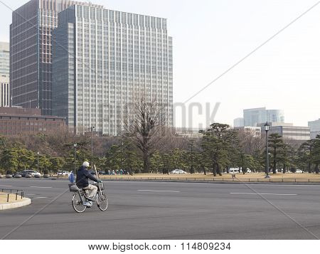 Cyclist Riding On The Road