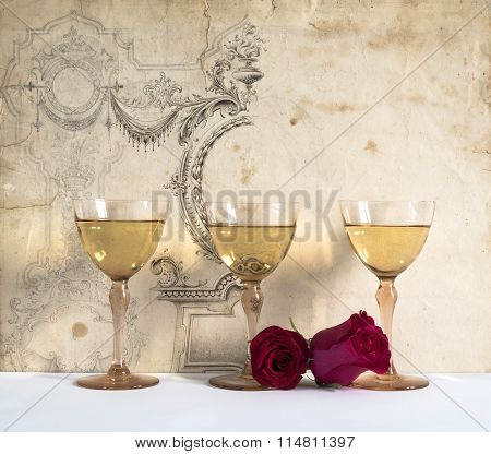 three glasses of white wine with rose on the decorative background, white background
