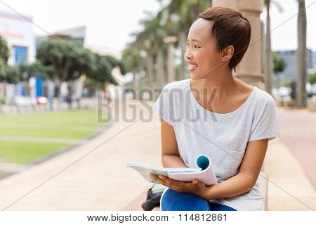 pretty afro american college girl outdoors looking away
