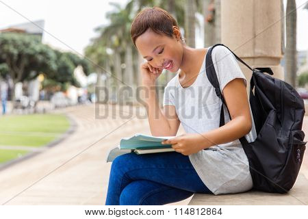 beautiful african american university student studying