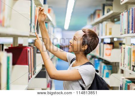 pretty african american college girl looking for a book in library