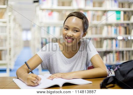 attractive african american university student sitting in library