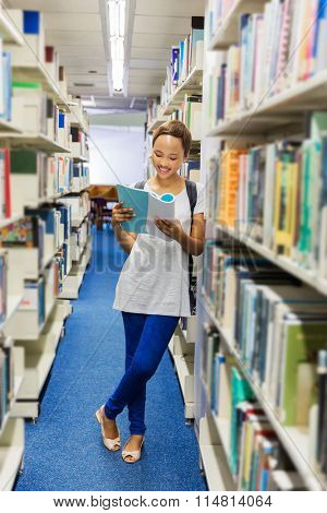 smart female african american student reading a book in library
