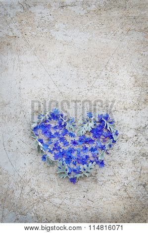 Heart of flowers on vintage background
