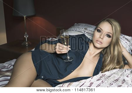 Sexy Girl On Bed With Champagne