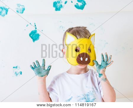 a messy with pig mask is painting
