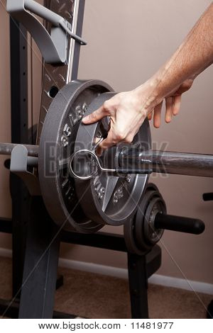 Removing weight from barbell