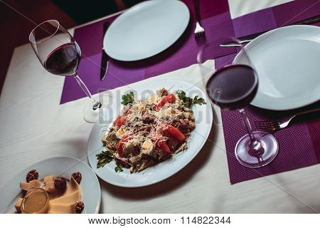 Glasses With Red Wine On The Table In The Restaurant