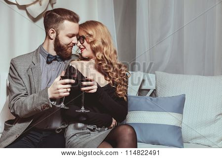Beautiful Young Loving Couple Sitting On A Bench