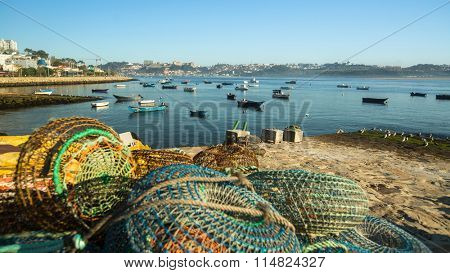 PORTO, PORTUGAL - NOV 7, 2015: Unidentified fishermen boats in the mouth of the Douro river. In 1996, UNESCO recognised Old Town of Porto as a World Heritage Site.