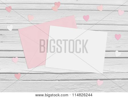 Valentines Day Or Wedding Mockup Scene With Envelope, Blank Card, Paper Hearts Confetti And Wooden B