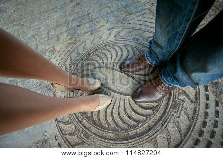 Legs man and woman, couple standing on the hatch