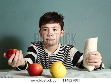 Boy Make Choice Between  Apples And Fast Food