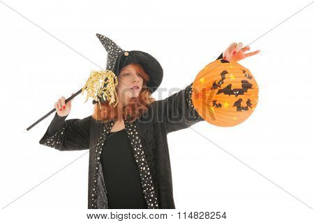 Young woman with red hair as evil witch during halloween isolated over white background