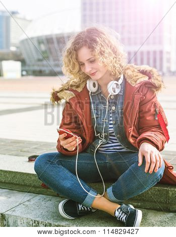 Young Hipster curly woman in the city