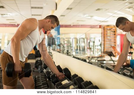 Young sportsman in gym.
