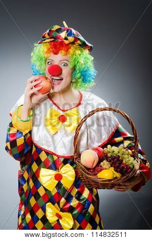 Clown with fruits in funny concept
