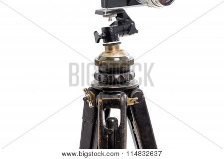 Closeup of old wooden tripod.