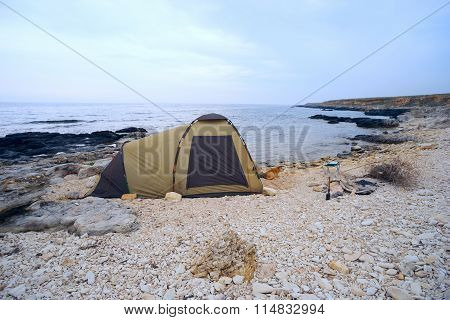 Tent On The Beach With  Dog At  Entrance .