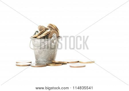 Bunch Of Golden Coins In A Small Bucket.