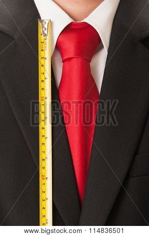 Black Suit, Red Tie, White Shirt And Centimeter.