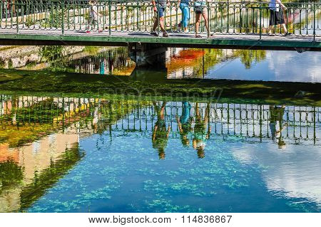 Reflecting People On A River In France