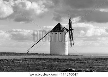 a traditional white windmill in Campo de Criptana, Spain, in black and white