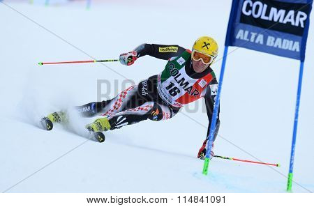 ALTA BADIA, ITALY - DECEMBER 22 2013: Competing in the AUDI FIS Alpine World Cup giant Slalom race on the Grand Risa course Alta Badia, Italy.