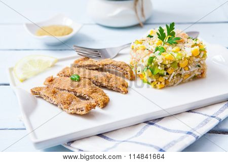 Quinoa salad with deep fried breaded vegan filet made of tofu