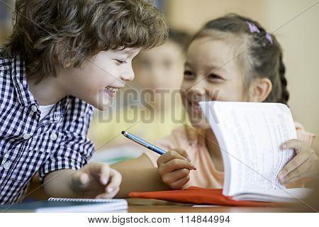 Smiling school children in classroom