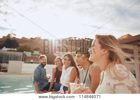 Group Of Friends Enjoying Poolside Party