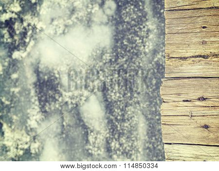 Retro Toned Old Wooden Pier On Ice, Abstract Background.