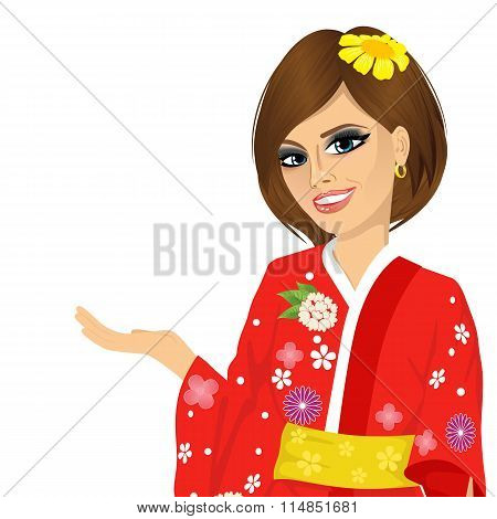 attractive asian japanese woman in red kimono holding something