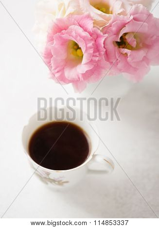Still life with  cup of coffee  and flowers (Eustoma).  Selective focus. Shallow depth of field.