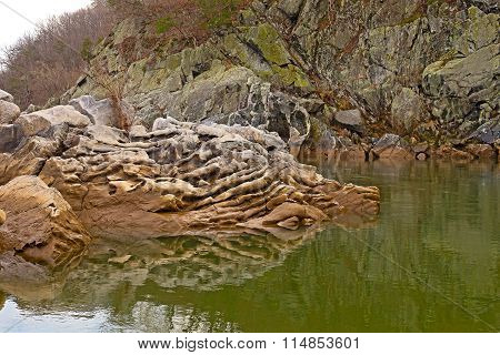 Whimsical rock formation in Potomac River at Great Falls Park in Maryland USA.