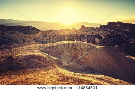 Retro Toned Sunset Over Zabriskie Point, Death Valley, Usa.