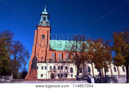 Statue and cathedral church in Gniezno