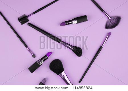Set of l make-up brushes on lavender background