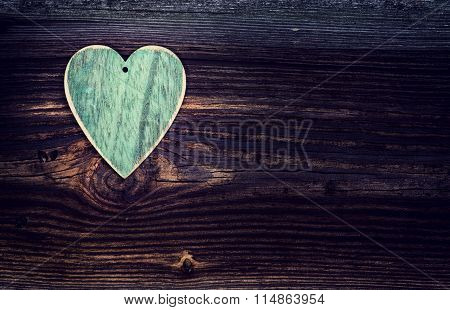 Green Wooden Heart On Old Table