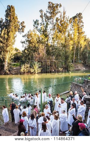 YARDENIT, ISRAEL - JANUARY 21, 2012: Christian pilgrims make  baptism ceremony in honor of Jesus Christ's baptism here.  They enter Jordan River waters