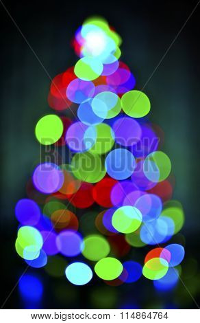 glowing blur christmas tree on  dark background