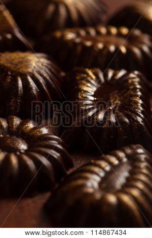 chocolate sweets with edible golden powdeer