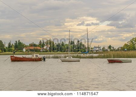 Fishing And Sailboats At Santa Lucia River In Montevideo