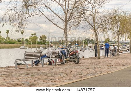 People At The Boardwalk Of Santa Lucia River In Montevideo