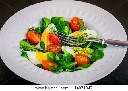 Fresh Green Salad With Lamb's Lettuce, Cherry Tomatoes And Eggs