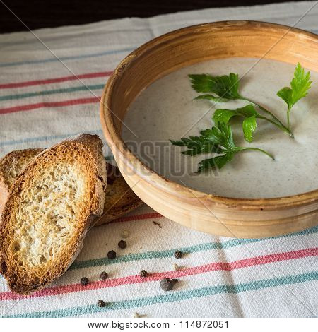 Ceramic Bowl With Mushroom Soup Puree With Bread