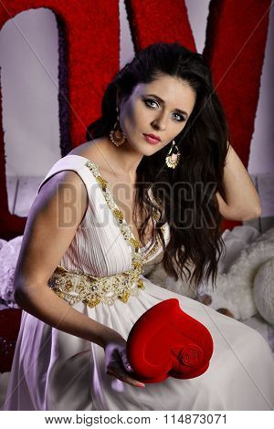 St. Valentine's Day. Very beautiful, pretty, nice, attractive, brunette girl, model with big heart, red heart, shape heart, heart casket, perfect heart, bright heart, true heart, symbol heart, romantic heart, heart.